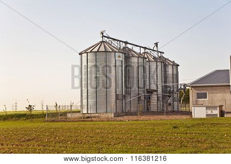 Silver Shining Silo With Acre In Landscape