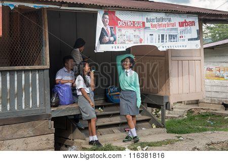 Group Of Teenagers In School Uniform On The Doorstep At Tana Toraja