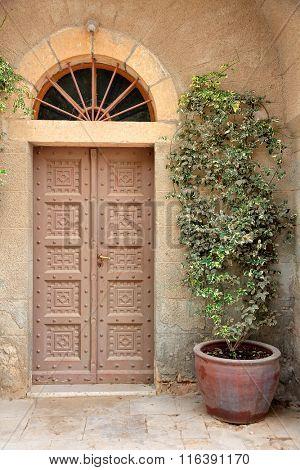 Antique wooden door in the Franciscan  monastery on Mount Tabor, Israel
