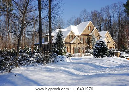 winter home, house in woods after snow in sunny day