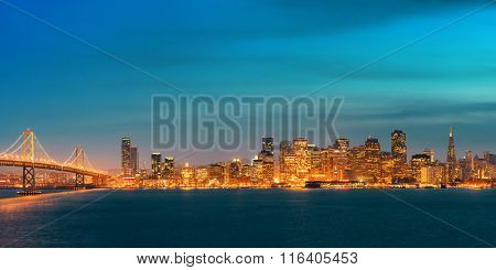 San Francisco city skyline panorama with urban architectures at night.