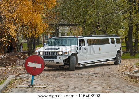 White Hummer H2 Limousine At The Rural Street
