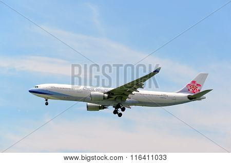 HONG KONG - JUNE 04, 2015: China Airlines aircraft landing at Hong Kong airport. China Airlines is the flag carrier and largest airline of the Republic of China (Taiwan)