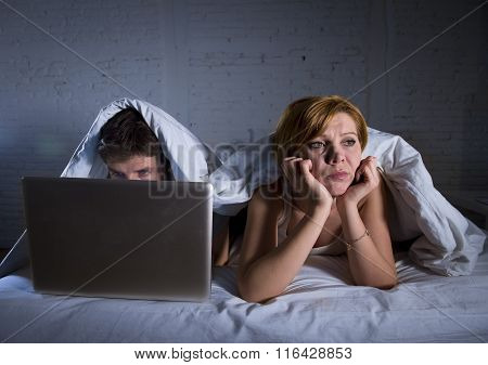 Young Wife Upset Unsatisfied And Frustrated In Bed While Husband Work On Computer Laptop Ignoring He