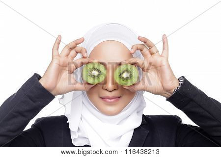 Muslimah Woman Eating Kiwi