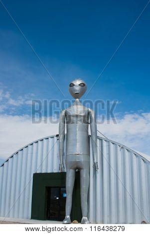 Alien Figure Stands Guard In Rachel, Nevada