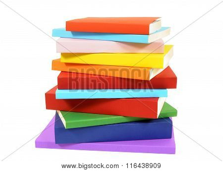 Closeup Untidy Small Pile Of Paperback Books Isolated On White Background