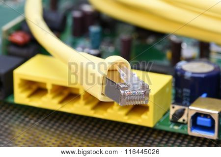 Close up of network cable with electronics router