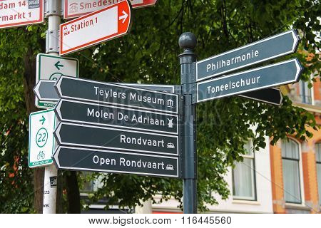 Tourist Signpost At The Crossroads In The Centre Of Haarlem, The Netherlands