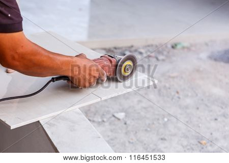 Labor cutting tile floor for new house building poster