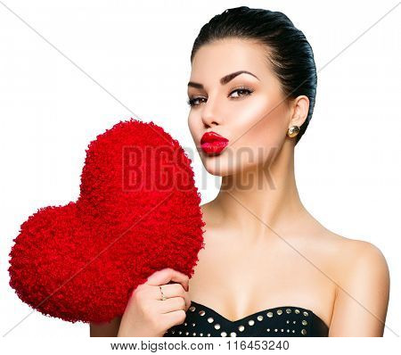 Sexy model Woman portrait. Gorgeous young brunette woman with heart shaped red pillow. Perfect make up. Kiss. Valentine' Day brunette lady headshot