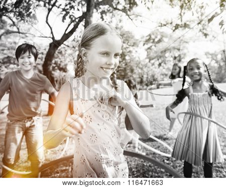 Group of Children Playing Hulahoop Concept