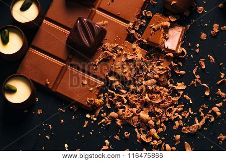 Many Candy And Chocolate Chips On A Black Background