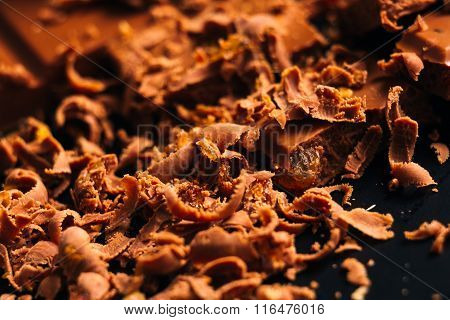 Lot Of Chocolate Chips On A Black Background