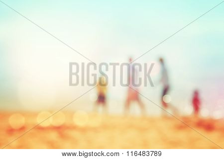 Family walking on the beach, blurred background image, Instagram toned,