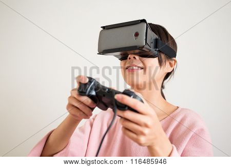Thrilled woman play with joystick and vr device