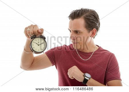 Young Man Is Angry At Alarm Clock