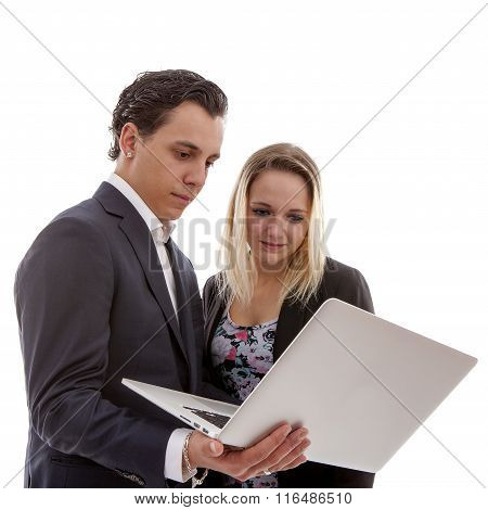 Young Business Couple Is Holding Laptop