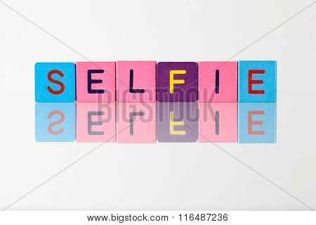 Selfie - An Inscription From Children's Blocks