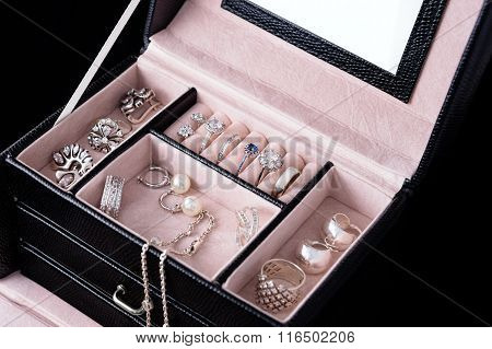 Jewelry box with white gold and silver rings, earrings and pendants with pearls. Collection of luxur