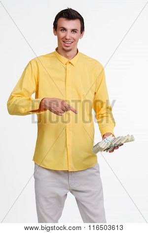 Young guy holding money.