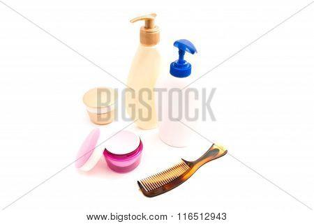 shower gel cream and hairbrush on white closeup poster