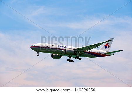 HONG KONG - JUNE 04, 2015: Malaysia Airlines aircraft landing at Hong Kong airport. Malaysia Airlines is the flag carrier of Malaysia and a member of the Oneworld airline alliance.