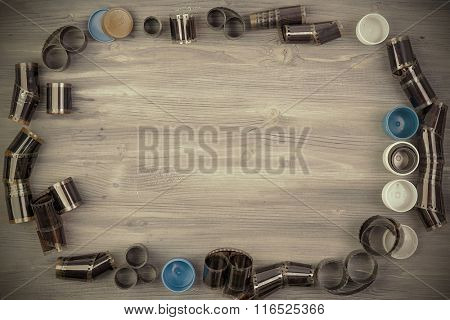 Old film with case on Wooden background