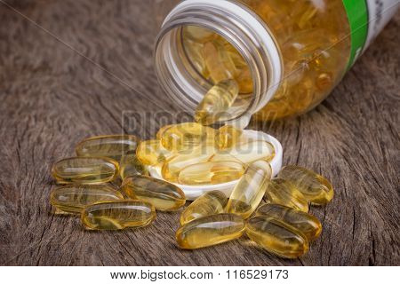 The container with pills of omega 3. Fish oil for cholesterol.