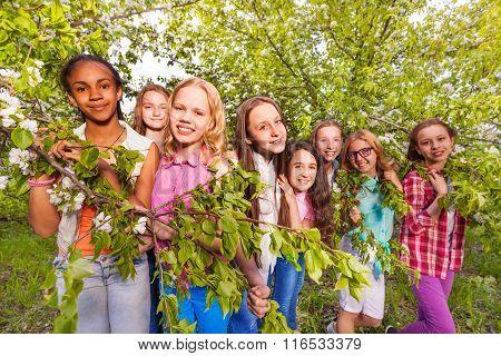 Group of girls in spring apple garden