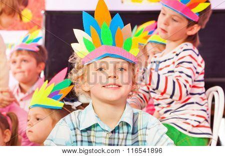 Portrait of blond boy wear handmade headwear