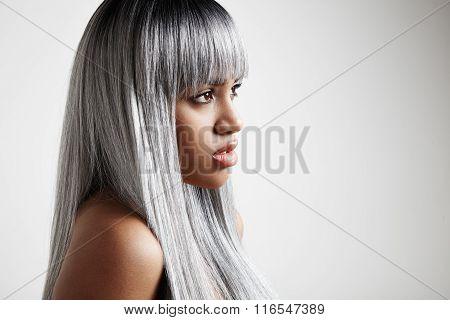 Blak Woman With A Grey Long Hair