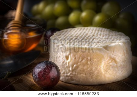 Wooden Board With Cheeses, Grapes, Nuts And Honey Light Paint