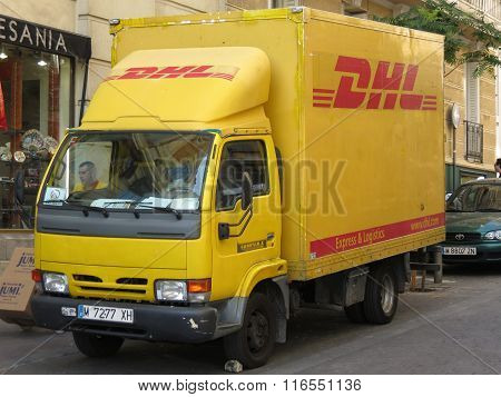 MADRID SPAIN - CIRCA JUNE 2015: DHL Deutsche post van parked in a street of the city centre. DHL is one of the leading private mail companies in Europe.