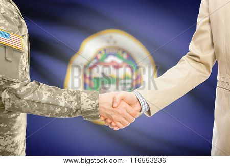 Usa Military Man In Uniform And Civil Man In Suit Shaking Hands With Usa State Flag On Background -