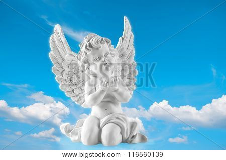 Guardian Engel On Blue Sky Background. Religion And Faith