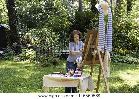Woman Is Painting