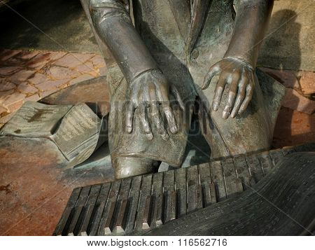 Metal sculpture of Frederic Chopin playing his 'Polonaise' on the piano