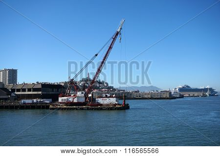Crane On Barge Does Pier Repair Work With Coit Tower On Top Telegraph Hill And Cruise Ship In The Di
