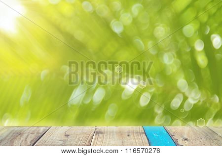 Nature Palm Leaf With Bokeh Sun Light On Old Empty Wood Table Background.