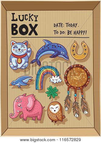Lucky amulets and happy symbols collection in a cardboard box