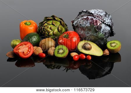 Fresh fruits and vegetables on reflective table
