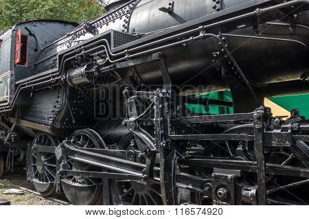 Black steel and iron symboloize the raw power of early 20th century steam locomotives.