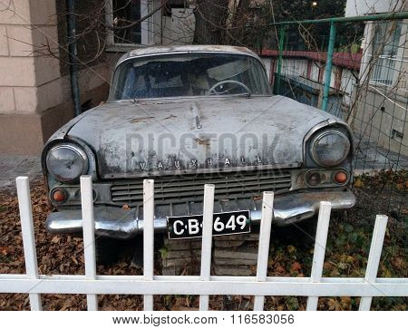 SOFIA, BULGARIA - DECEMBER 29, 2013: Retro Vauxhall car abandoned in a yard in Sofia, Bulgaria
