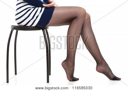Beauty woman legs in black tights. Part body of slim attractive girl wearing striped dress skirt and pantyhose isolated on white. poster