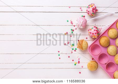 Colorful  Cake Pops On White Wooden Background.