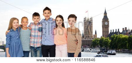 happy smiling children hugging over london