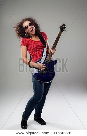 Female Rockstar Playing On Guitar