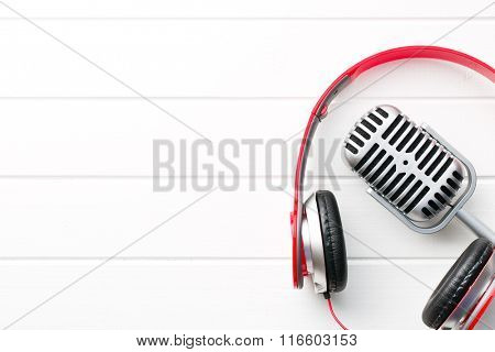 the vintage silver microphone and headphones