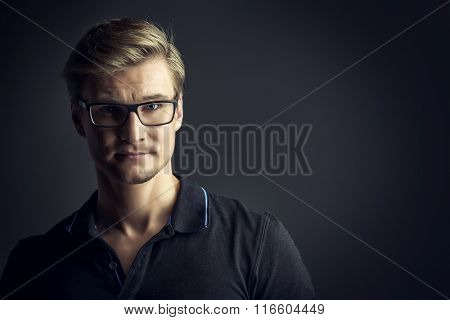 Portrait of a handsome young man in spectacles.